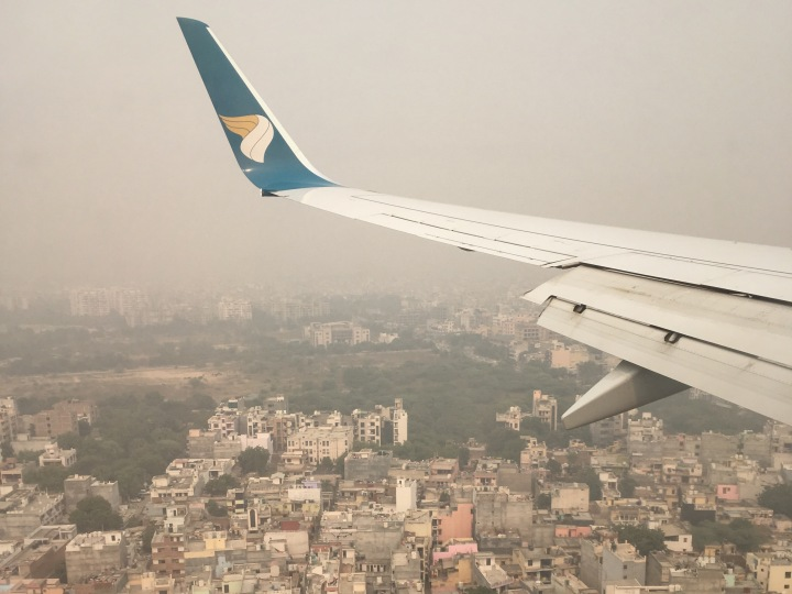 oman air plane landing in new delhi airport india